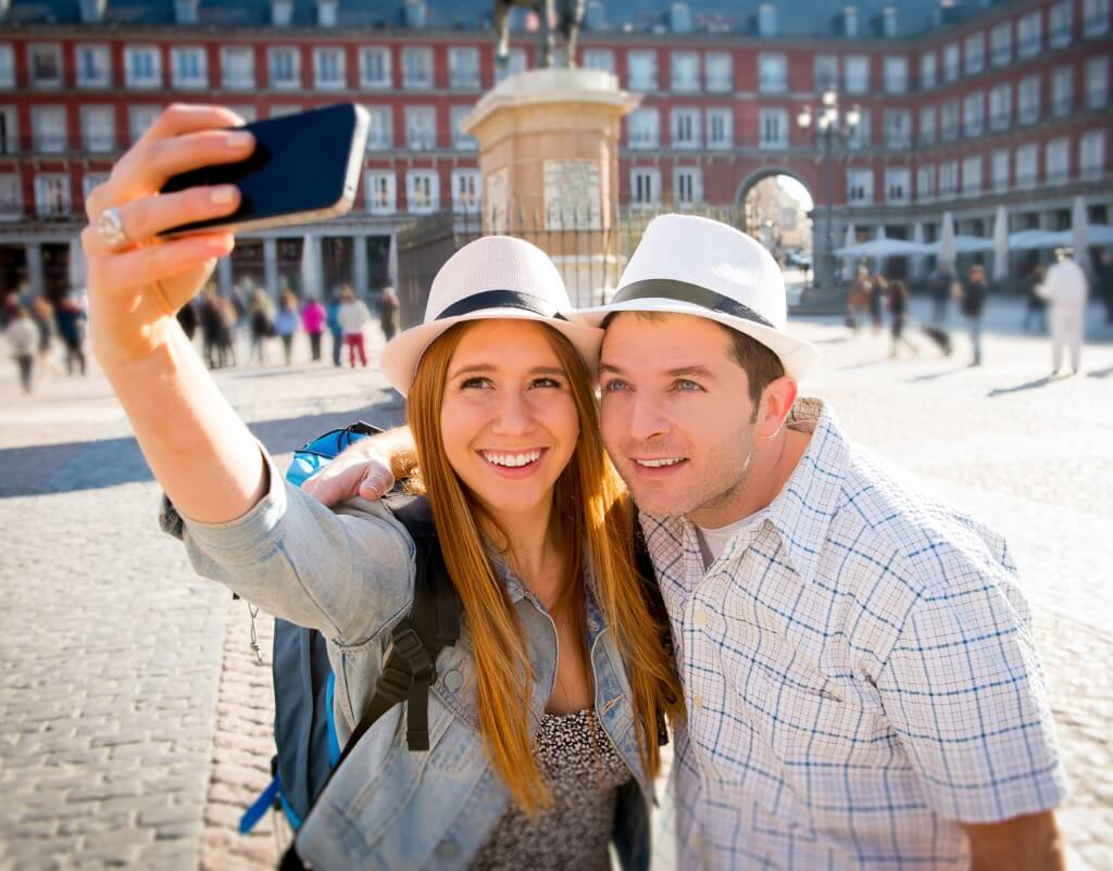 friends tourist couple visiting Europe in holidays taking selfie